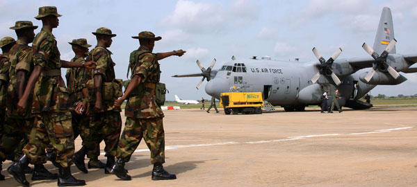 Nigerian troops with US C130 - Image in the public domain